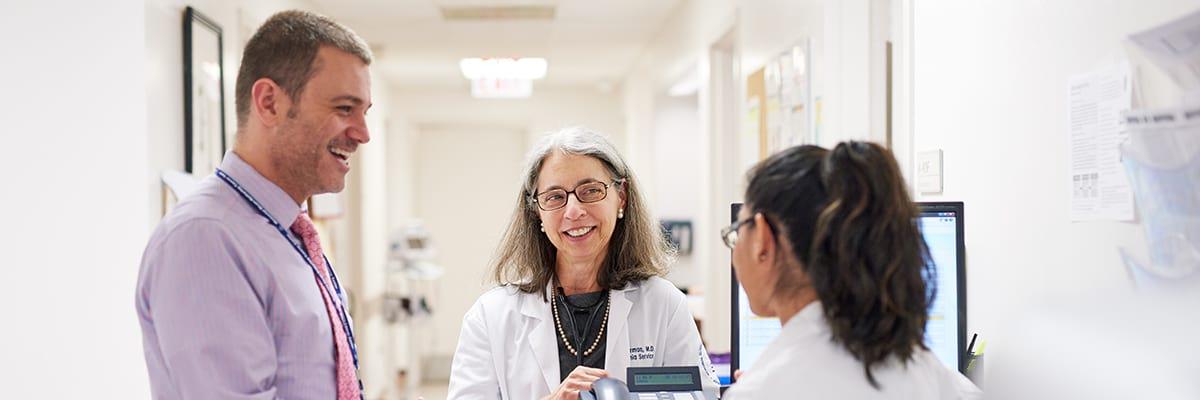 Larry Buie, Clinical Pharmacy Specialist (left) Ellin Berman, MD (center) and Sara De La Cruz, RN