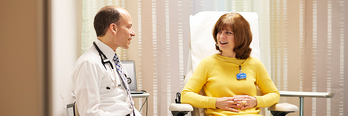 Medical oncologist John Gerecitano meets with a lymphoma cancer patient