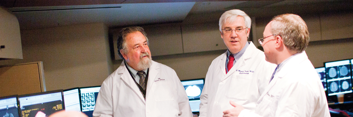Nuclear medicine physician Steven Larson consults with endocrinologist R. Michael Tuttle and oncologist Eric Sherman