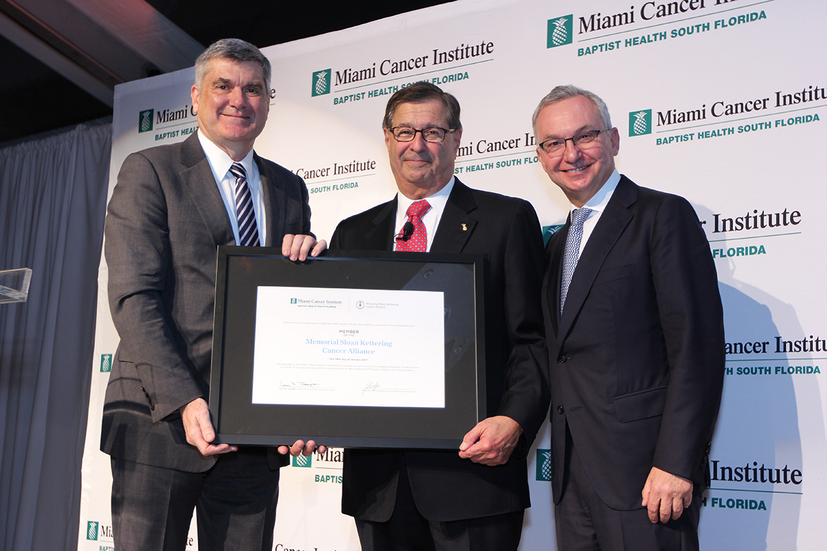 MSK President Craig Thompson; Miami Cancer Institute Founding Chief Executive Officer & Executive Medical Director Michael Zinner; and MSK Physician-in-Chief and Chief Medical Officer José Baselga pose with MCI's MSK Cancer Alliance certificate.