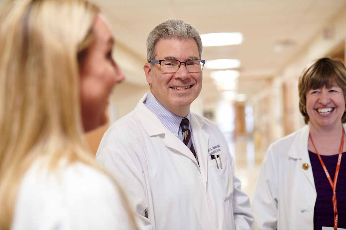 Leukemia expert Martin Tallman consults with his nursing team