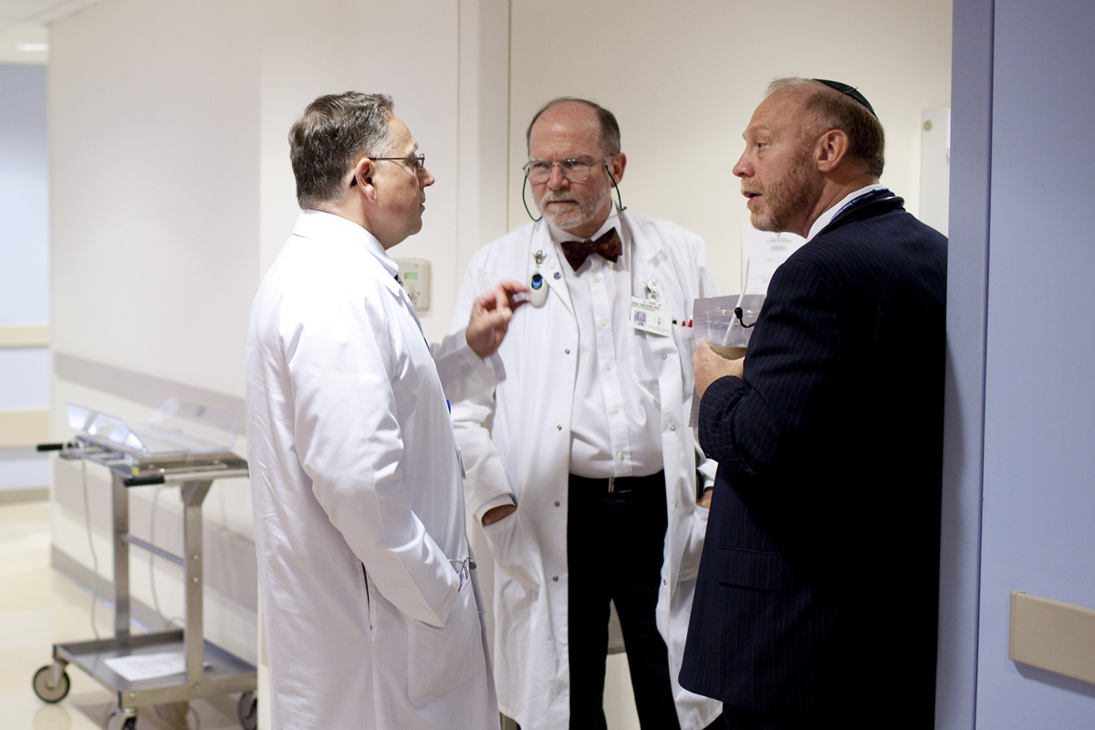 (From left) Pediatric surgeon Michael La Quaglia talks with sarcoma experts Paul Meyers and Leonard Wexler.
