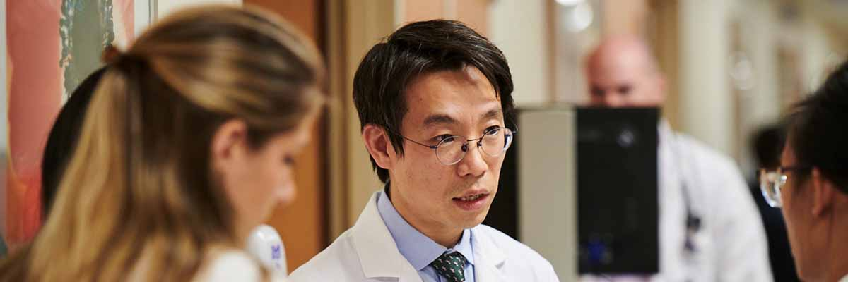 MSK leukemia expert Jae Park speaks with fellows
