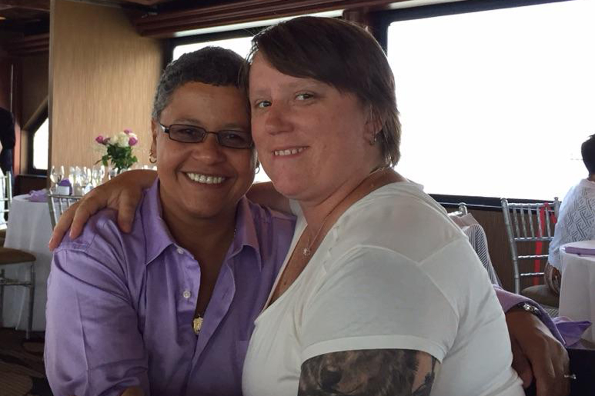 Memorial Sloan Kettering ovarian cancer patient Vilma Rosario and her partner, Michele Freeman, at a restaurant.