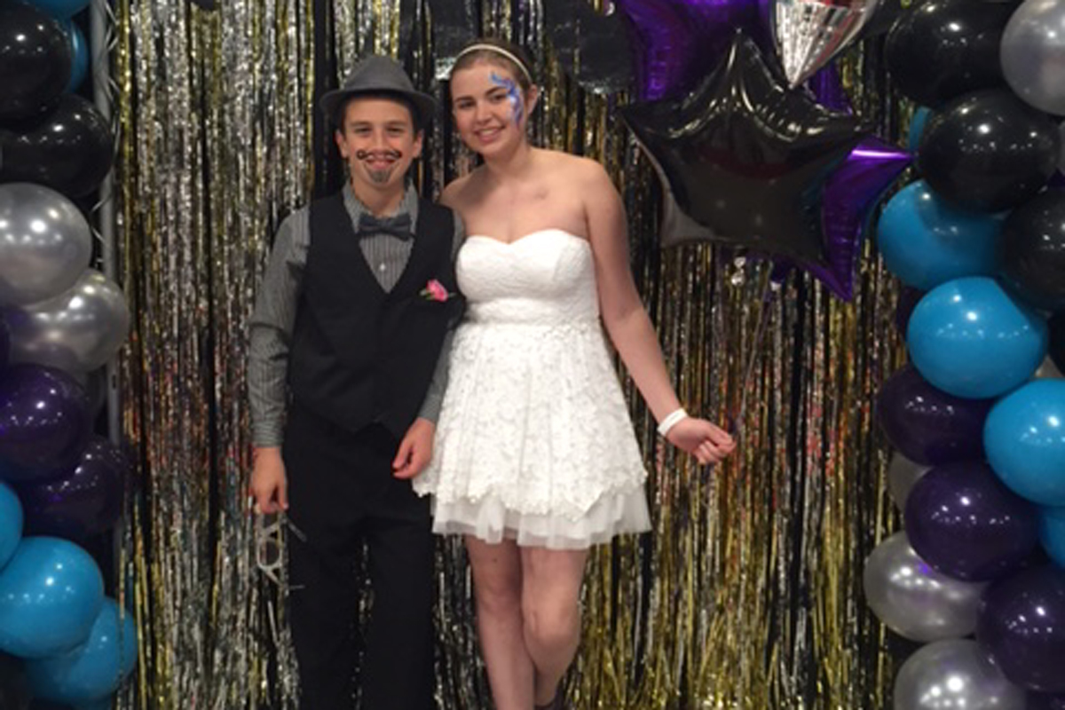 Memorial Sloan Kettering osteosarcoma patient Grace Franzese and her younger brother at the Department of Pediatrics' prom.