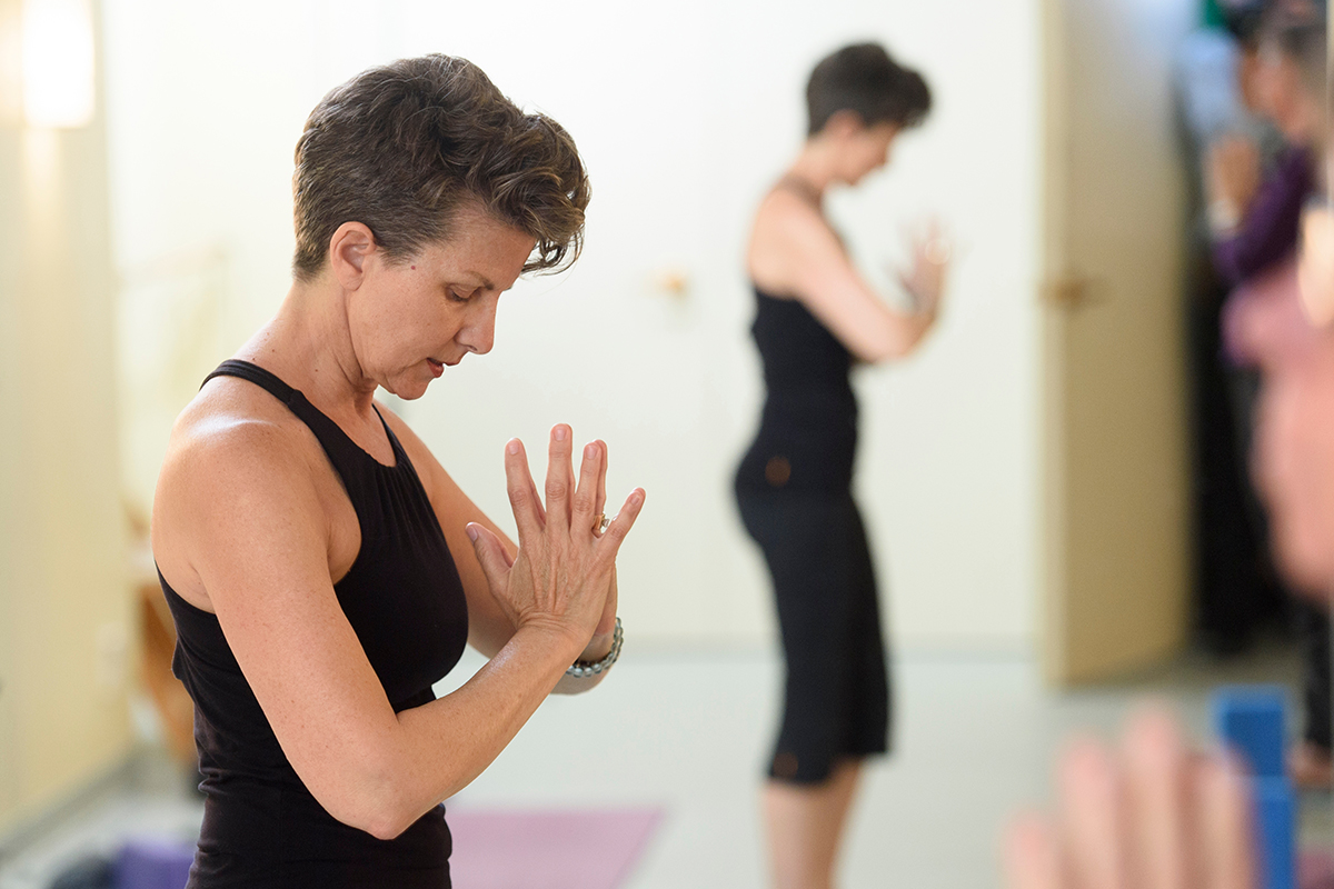 Yoga therapist Catherine Genzler leading a class