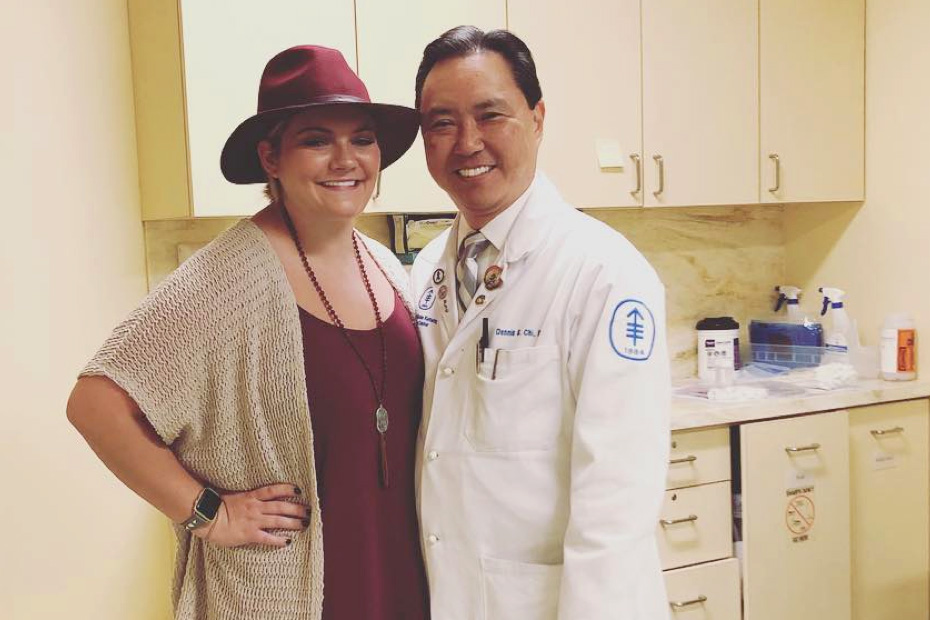 Young woman posing with doctor