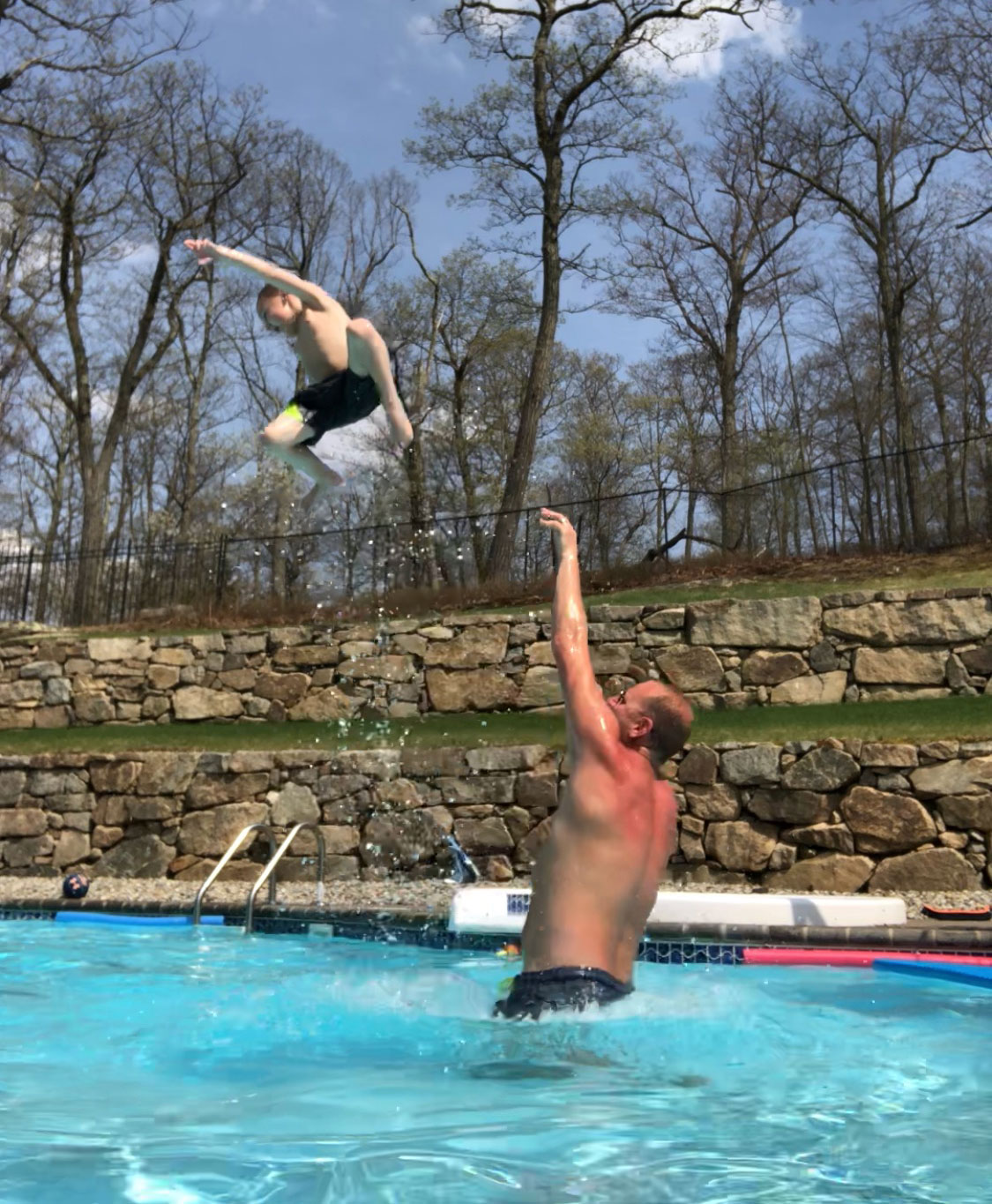 Man throws his son in the pool