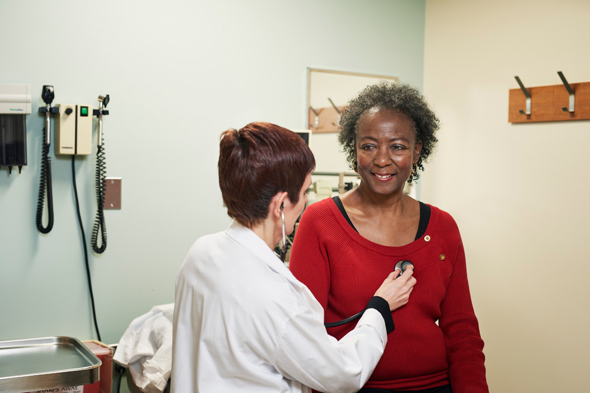 Hematologist Juliet Barker with a patient.