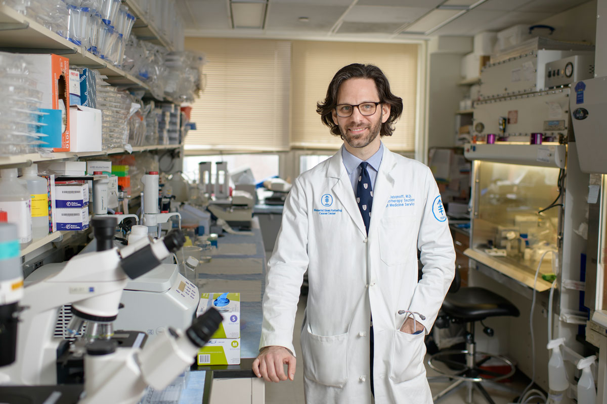 In his lab, physician-scientist Christopher Klebanoff is studying immunotherapies for people with breast cancer.