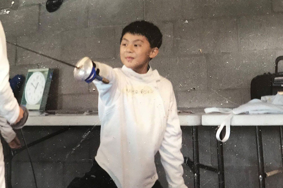 Gabe Armijo as a child wearing fencing gear