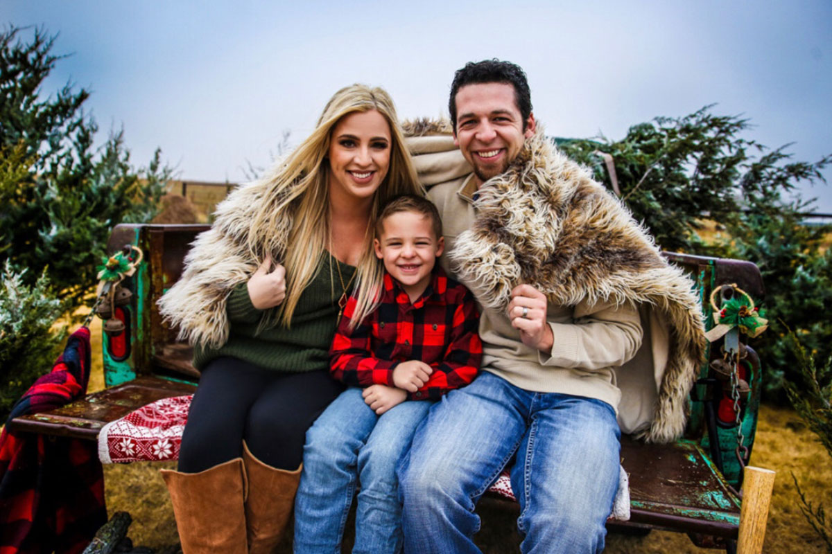 Kara Kenny and her husband Brandon with their son Preston.