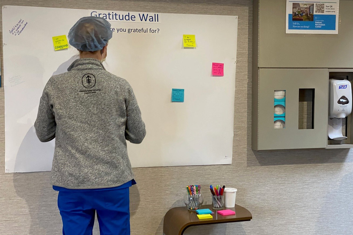 MSK employees taking a moment to share thoughts and observations on the Gratitude Wall.