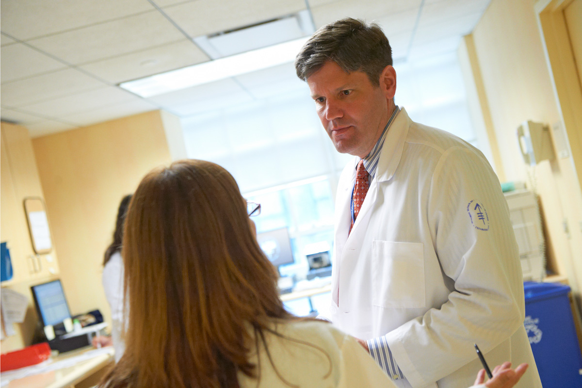 MSK medical oncologist Paul Sabbatini discusses treatment for ovarian cancer with a nurse