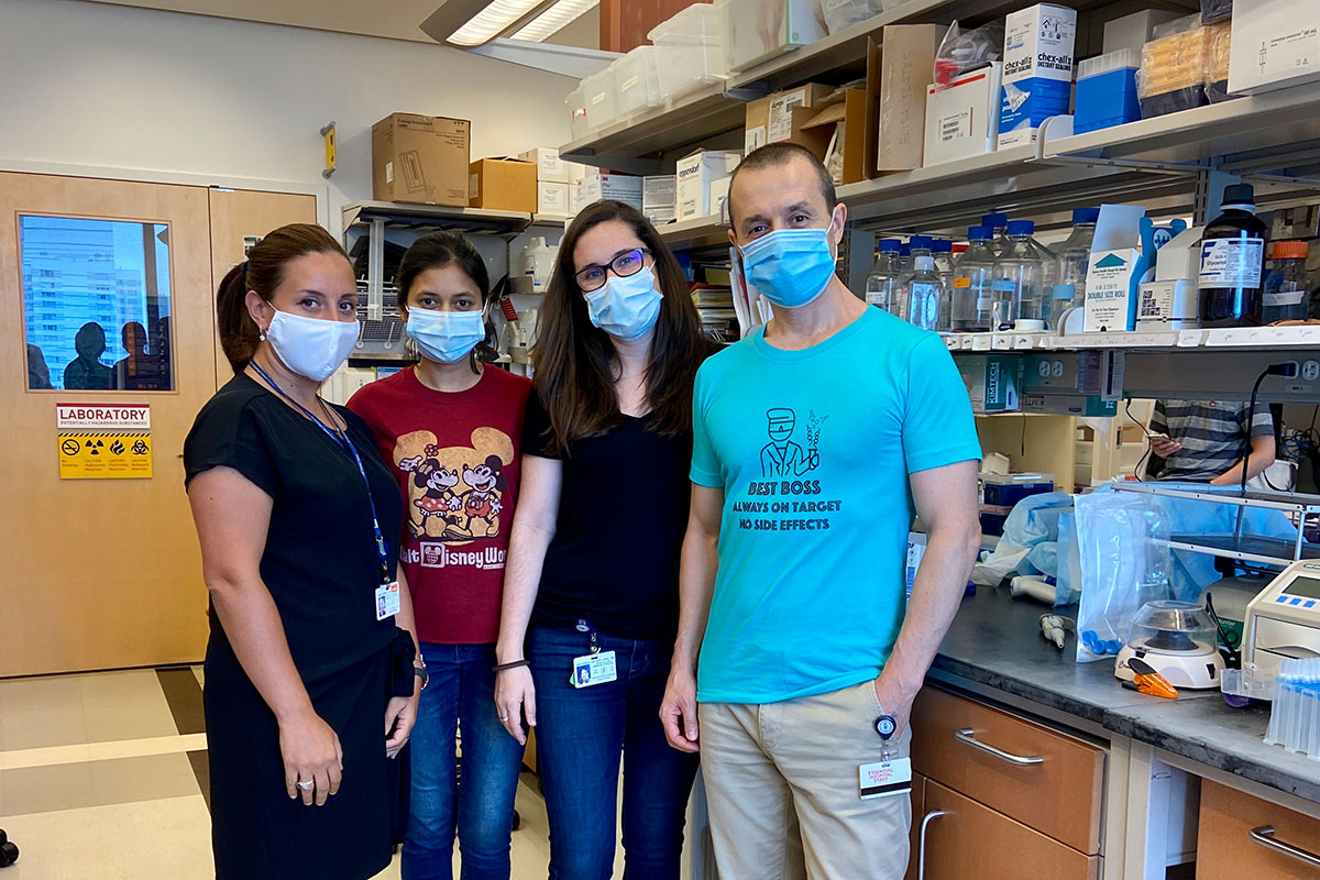 The study co-authors wearing masks and posing in the lab