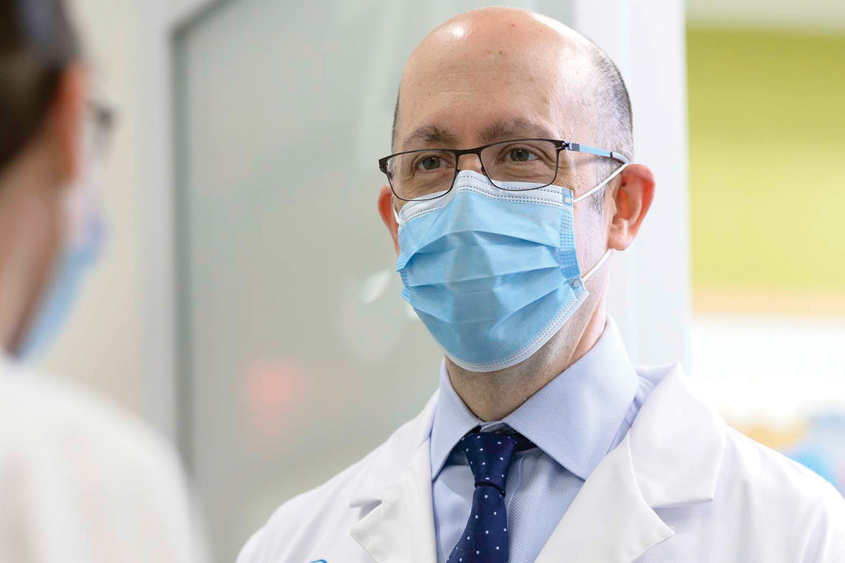 Medical oncologist Matthew Matasar is seen talking to a colleague