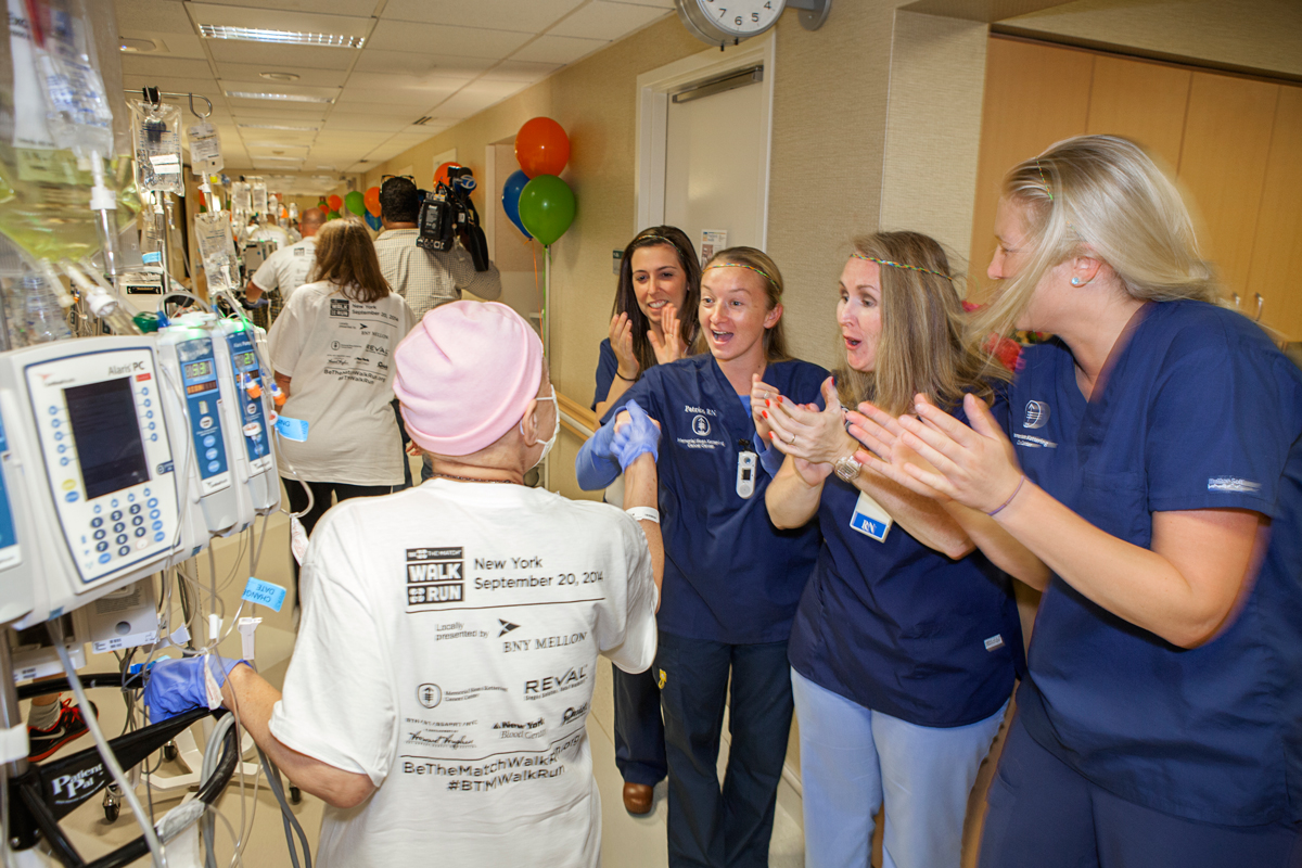 Patient Frances Pipino is cheered on by MSK staff.