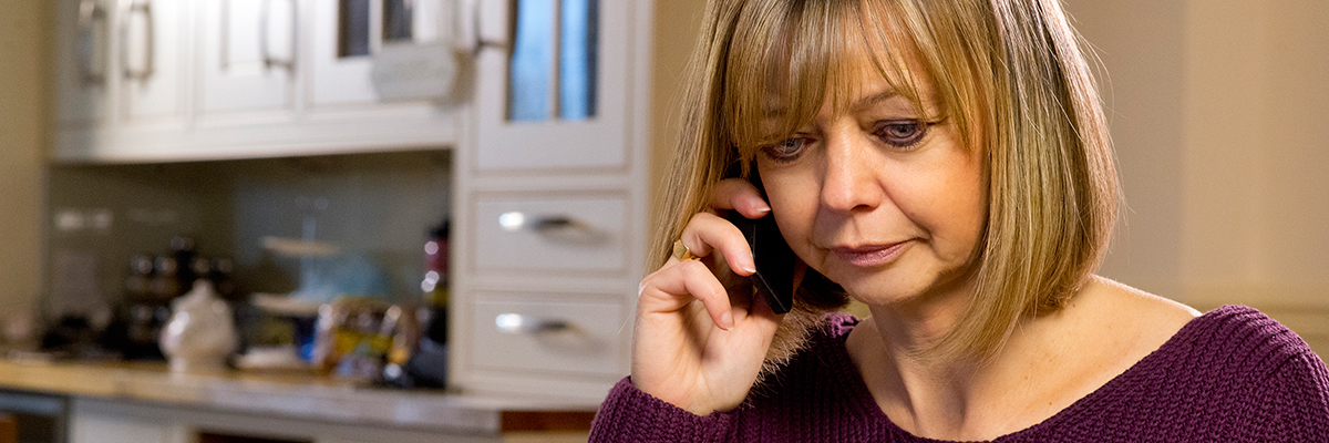Woman on the phone discussing financial assistance options