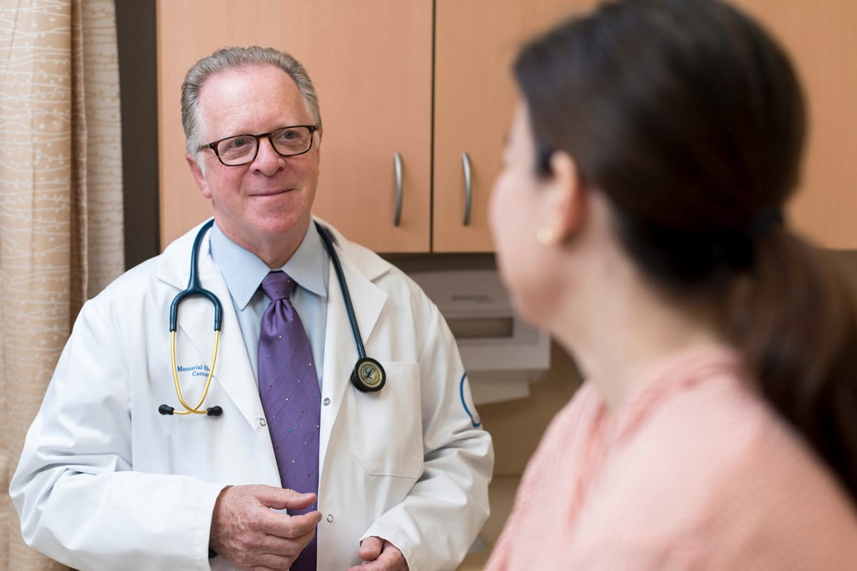 Memorial Sloan Kettering medical oncologist Andrew Seidman discusses treatment options with a breast cancer patient.