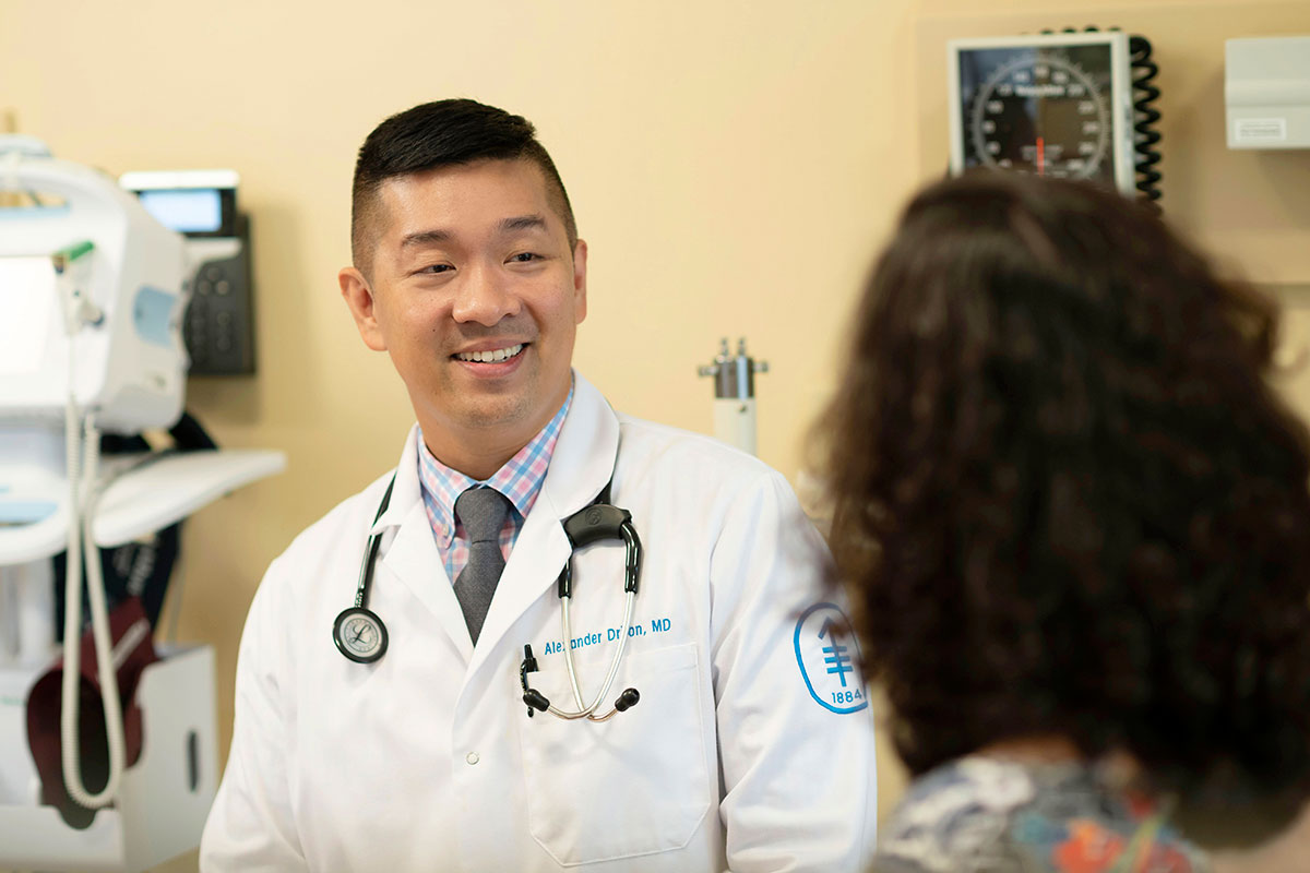 MSK medical oncologist Alexander Drilon with a patient