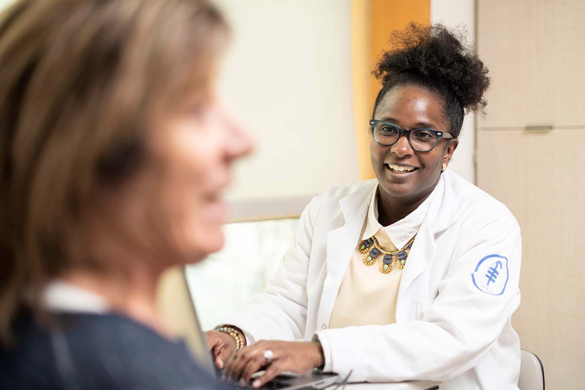 Clinical trials nurse Asia McCoy helps patients learn about new treatments available at MSK.