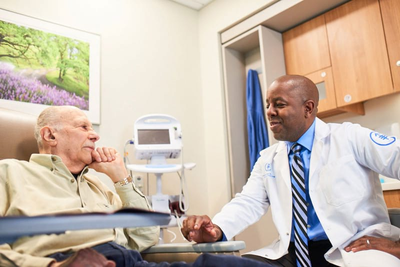 MSK radiologist speaks with a patient about his care