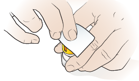 Figure 4. Cleaning the top of the vial.