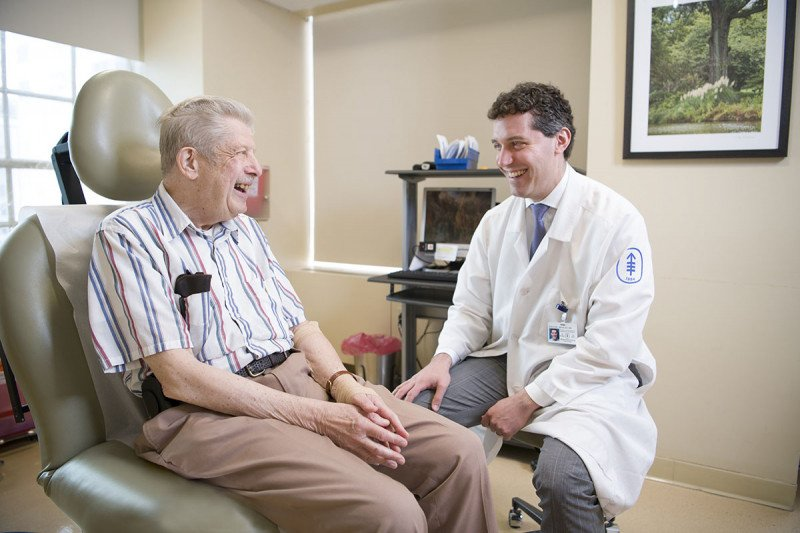MSK melanoma doctor Michael Postow with a patient