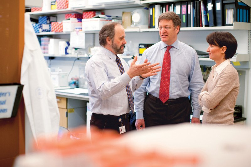 Pathologists Marc Ladanyi (left) and Cristina Antonescu collaborate with surgeon Samuel Singer