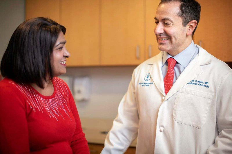 MSK radiation oncologist Oren Cahlon meets with a patient.