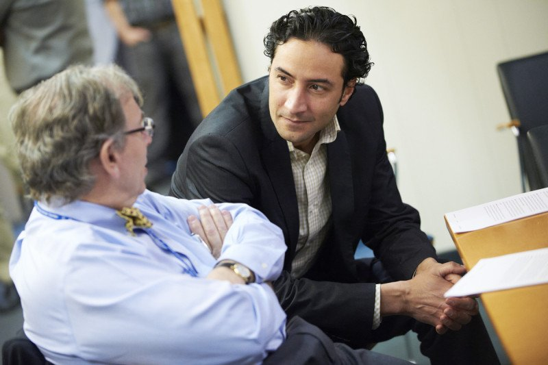 Pathologist Victor Reuter discusses a patient's case with surgeon Karim Touijer