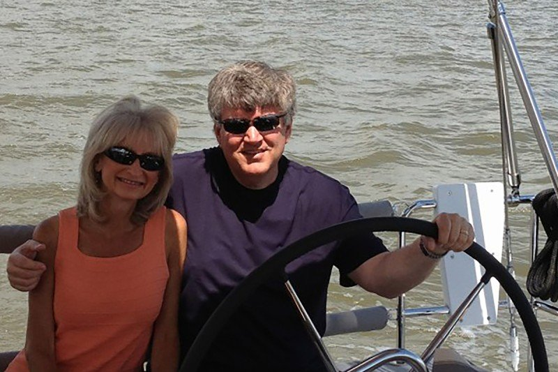 Bladder cancer survivor and his wife on a sailboat.