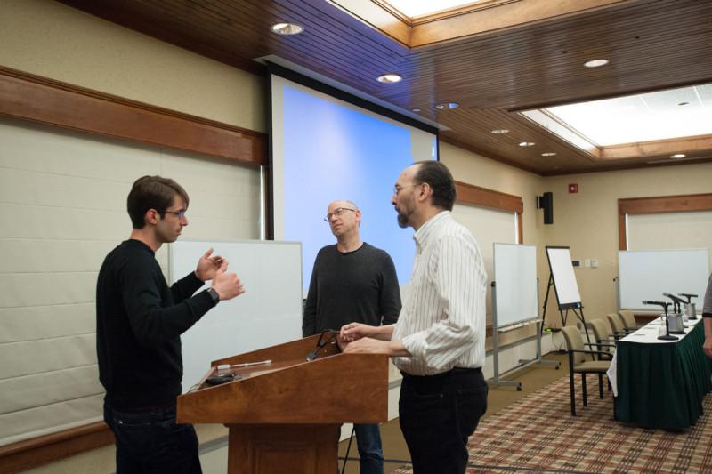 GSK alumnus John Maciejowkski talks with GSK Dean Ken Marians and Charles Rudin