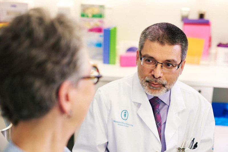 MSK squamous cell carcinoma expert, Ashfaq Marghoob, speaks with a current female patient.