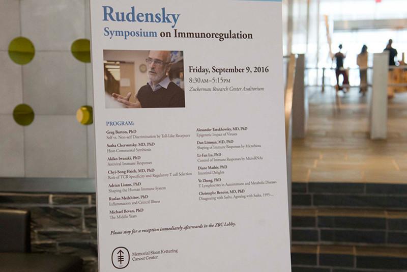 Post listing names of symposium speakers.