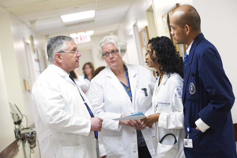 MSK Hematologists Gerald Soff (left) and Rekha Parameswaran (second from right) confer with nurse Janeen Crowley (second from left) and session assistant Jaime Garofil (right).