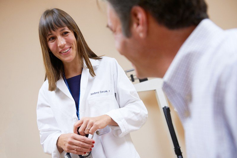 Andrea Cercek, a medical oncologist in MSK's Gastrointestinal Service, speaking to a patient.