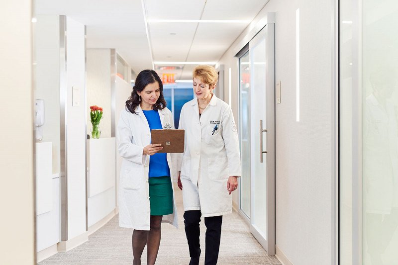 Doctor consulting with a nurse