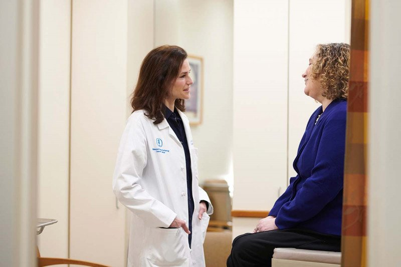 MSK endocrinologist Eliza Geer meets with a patient.