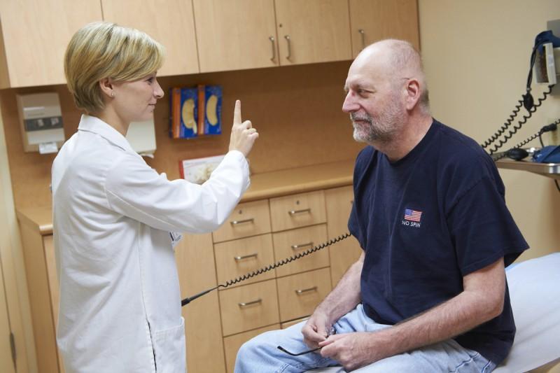 Nurse practitioner Alison Gilgan examines a patient.