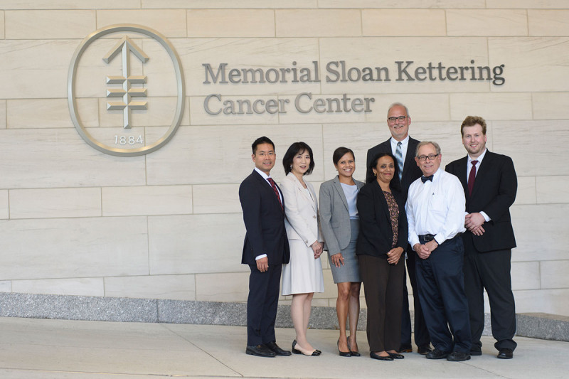 Group of people in front of Memorial Sloan Kettering Cancer Center sign