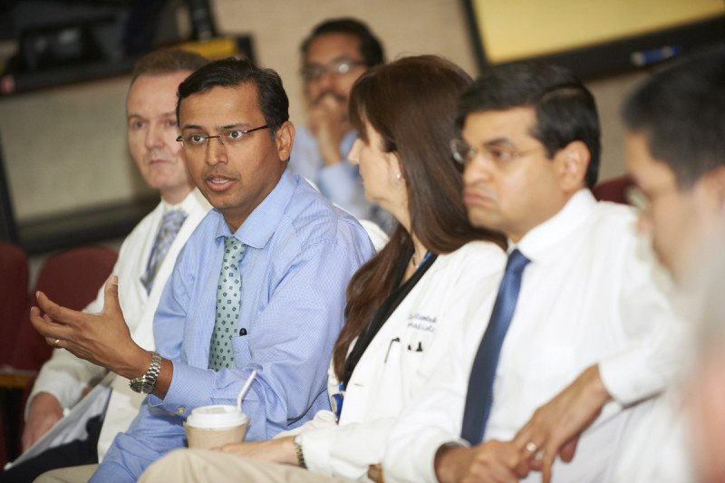Head and Neck Surgeon Bhuvanesh Singh presents a patient's case study to fellow MSK team members.