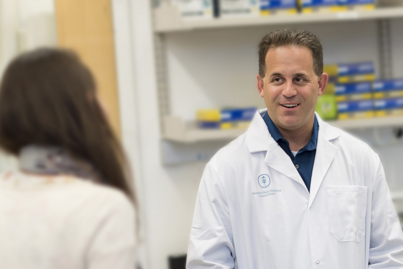 Physician-scientist Ross Levine in a white lab coat