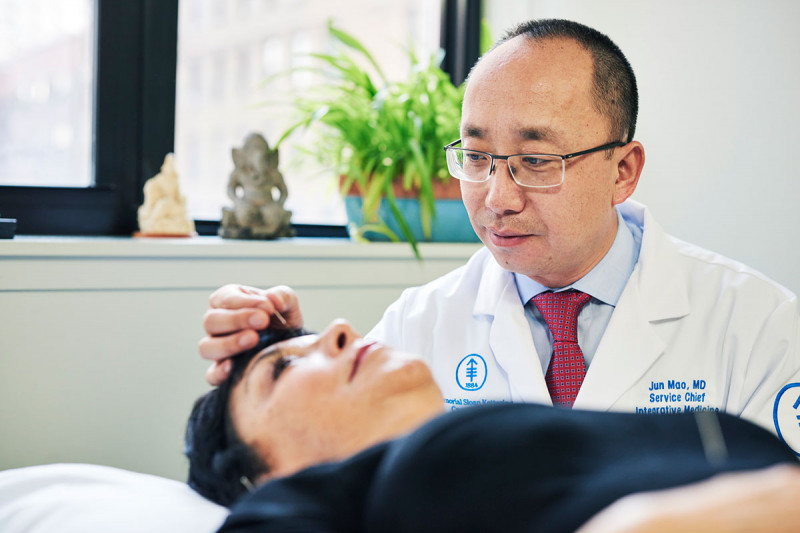 Jun Mao, Chief of MSK's Integrative Medicine Service, delivers acupuncture