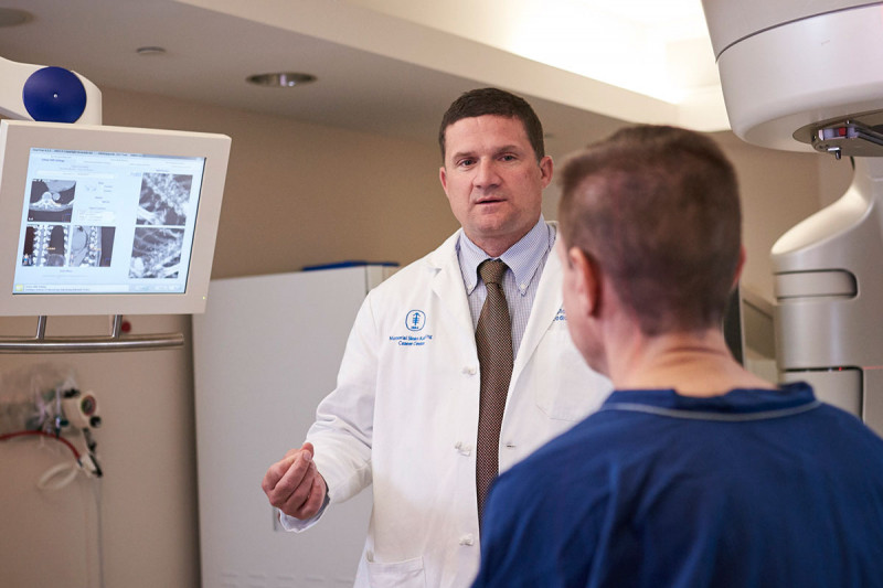Memorial Sloan Kettering radiation oncologist Christopher Crane speaks with a patient.