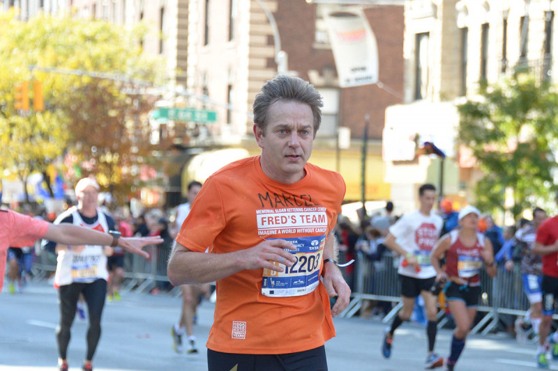 MSK physician-scientist Marcel van den Brink running the 2016 New York City marathon