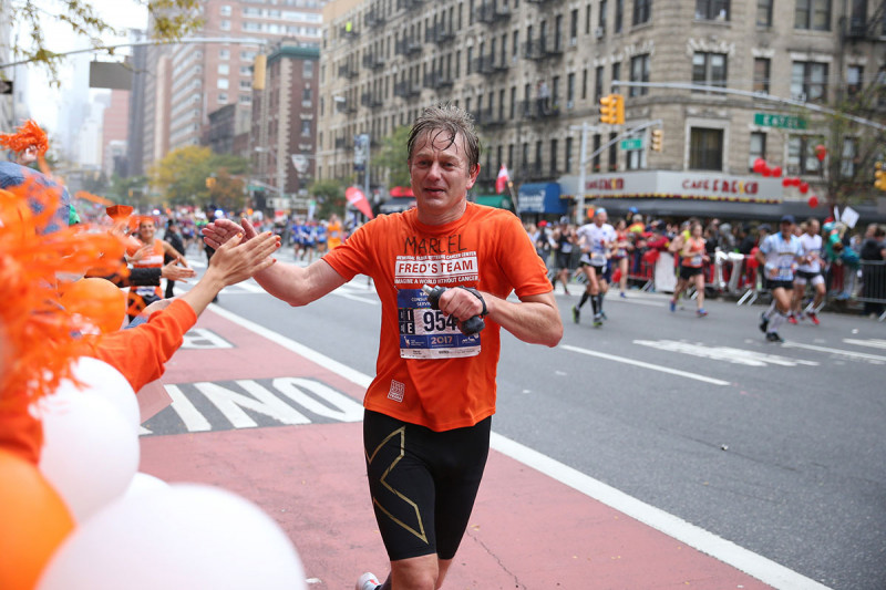 MSK physician-scientist Marcel van den Brink running the 2017 New York City marathon