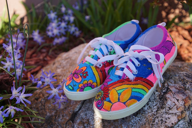 A pair of kids' sneakers featuring doodles from an MSK patient