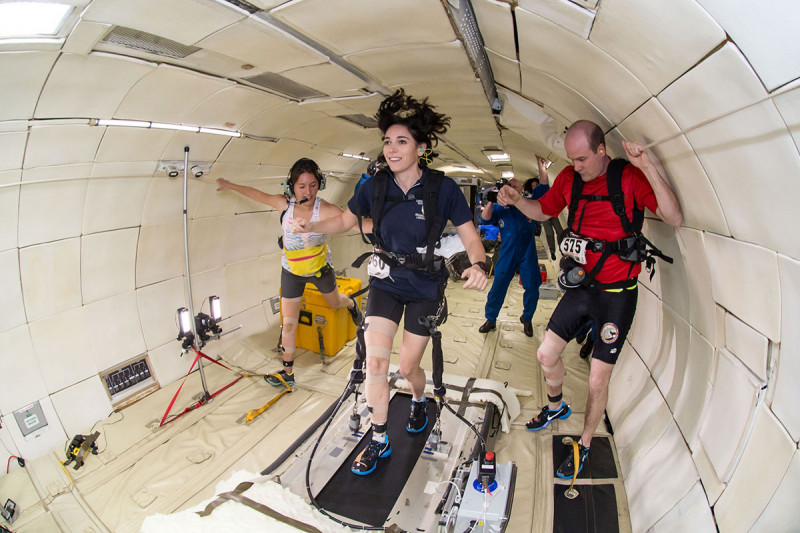Three people in weightless environment
