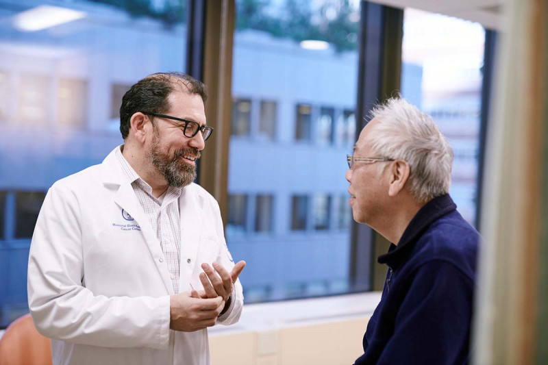 MSK medical oncologist Luis Diaz, Jr., speaks with a patient